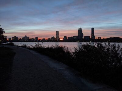 orange peaking out over the boston skyline
