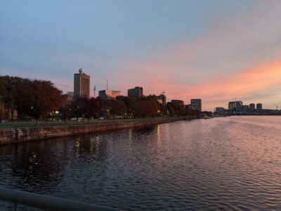 MIT buildings by the Charles with lightly colored clouds