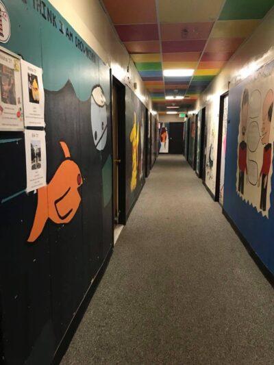 the hallway outside nisha's room
