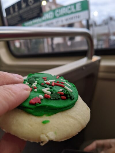 green cookie, with Cleveland circle sign out of focus in the background