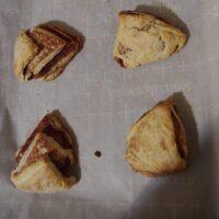 Cinnamon scones on a baking sheet.