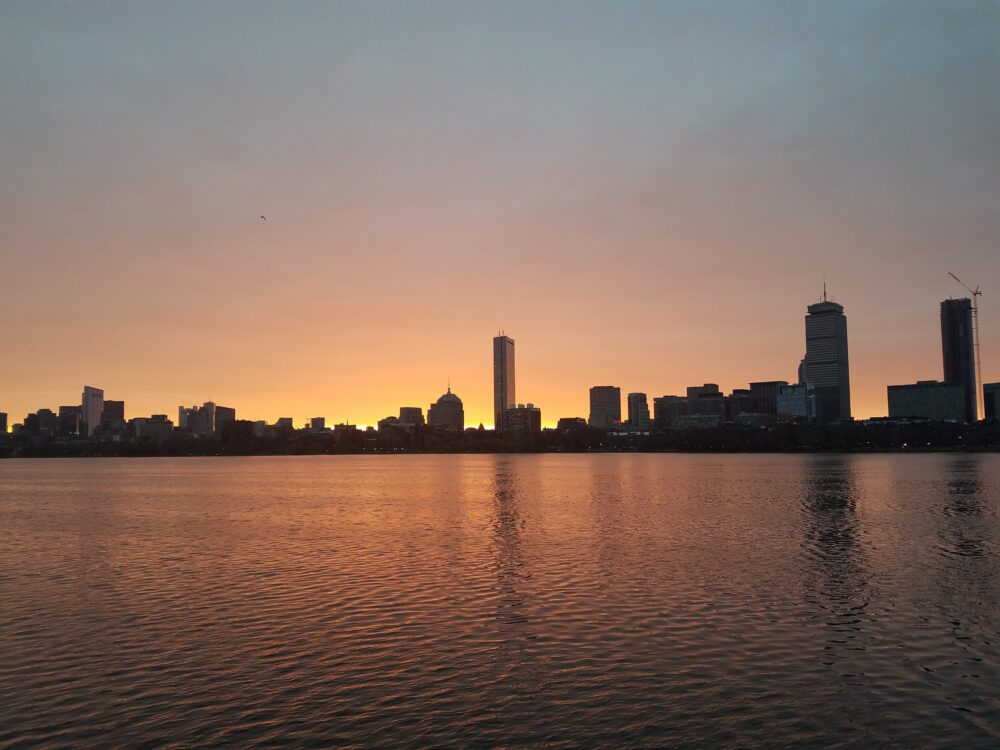 a sunrise over boston skyline