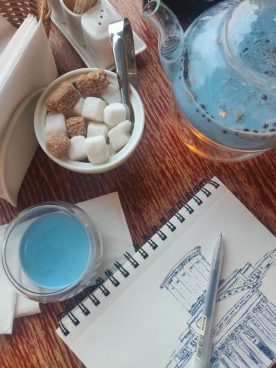 drawing of a building on table with tea