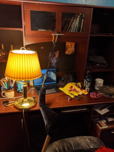 desk with lamp, thread and tools, and computer