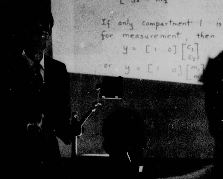 picture of person lecturing with overhead transparencies