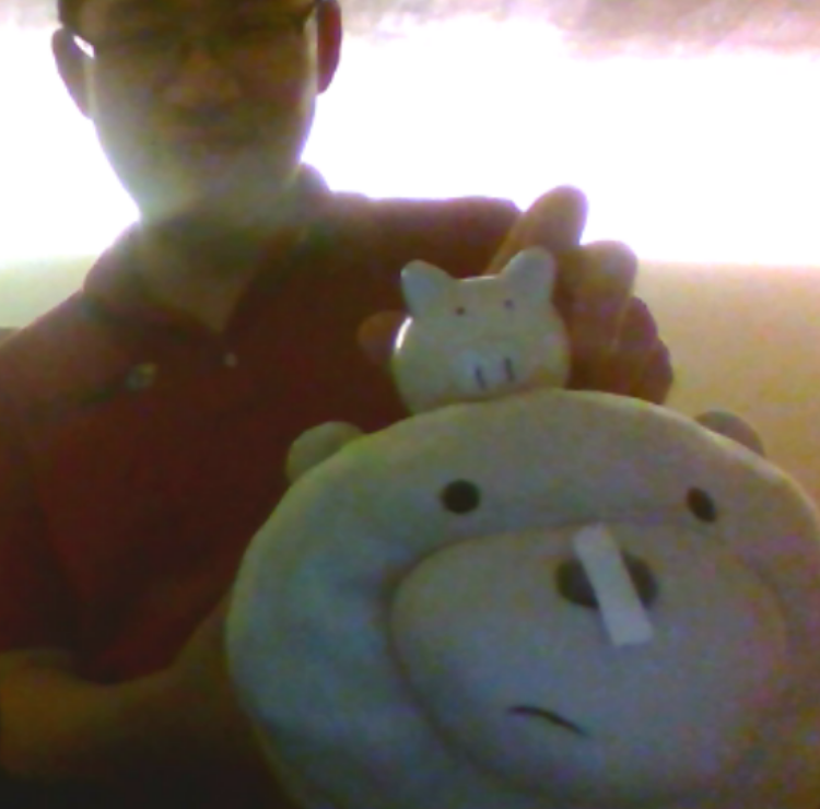 yannick (person) holding up yannick (pig) on top of ice bear pretending to be pig