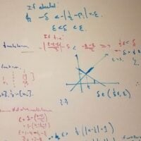 many equations on whiteboard