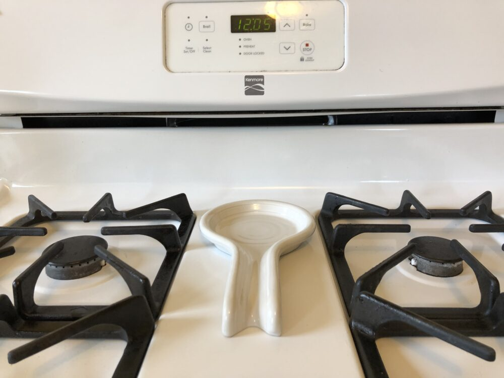 a photo of a spoon rest on the stove