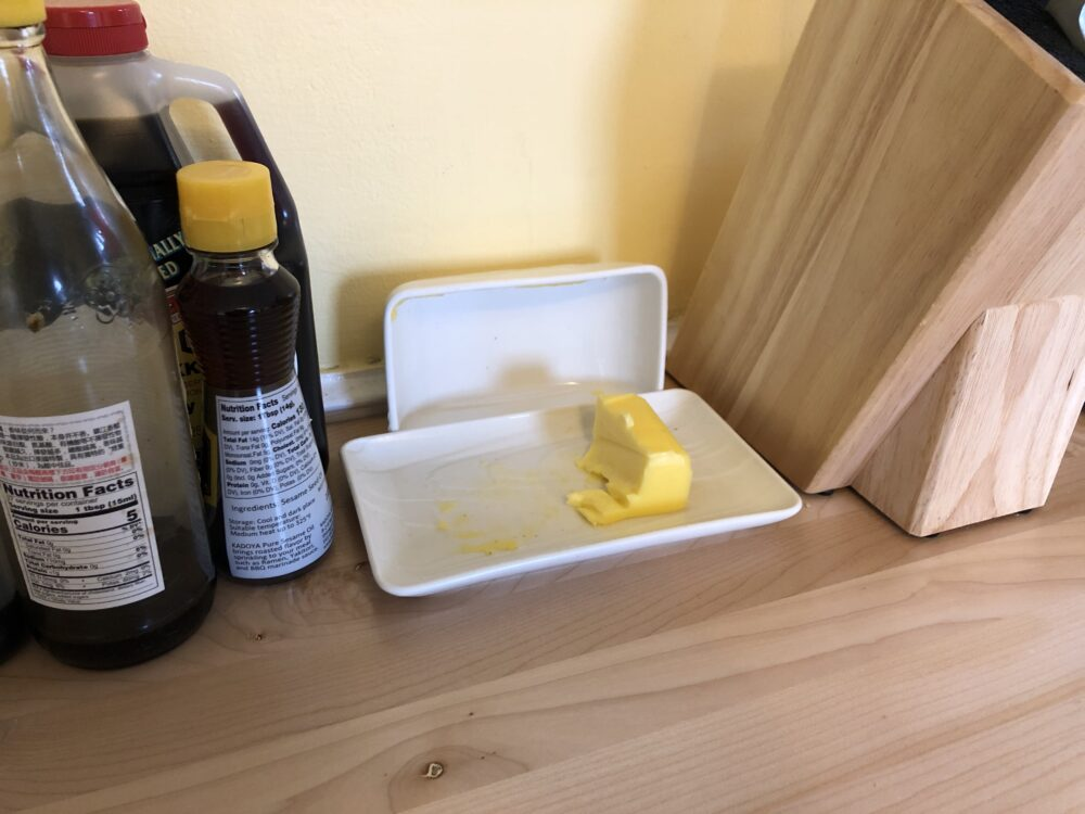 a photo of a butter dish, with butter on it
