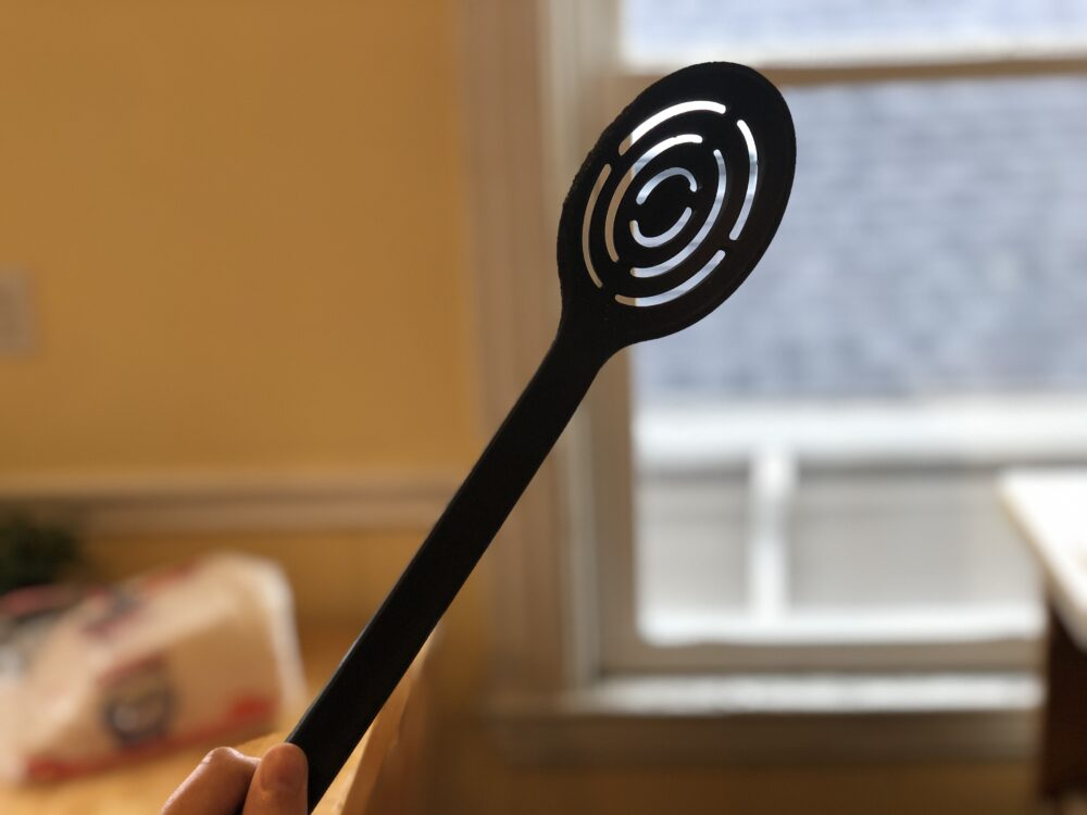 a photo of slotted spoon
