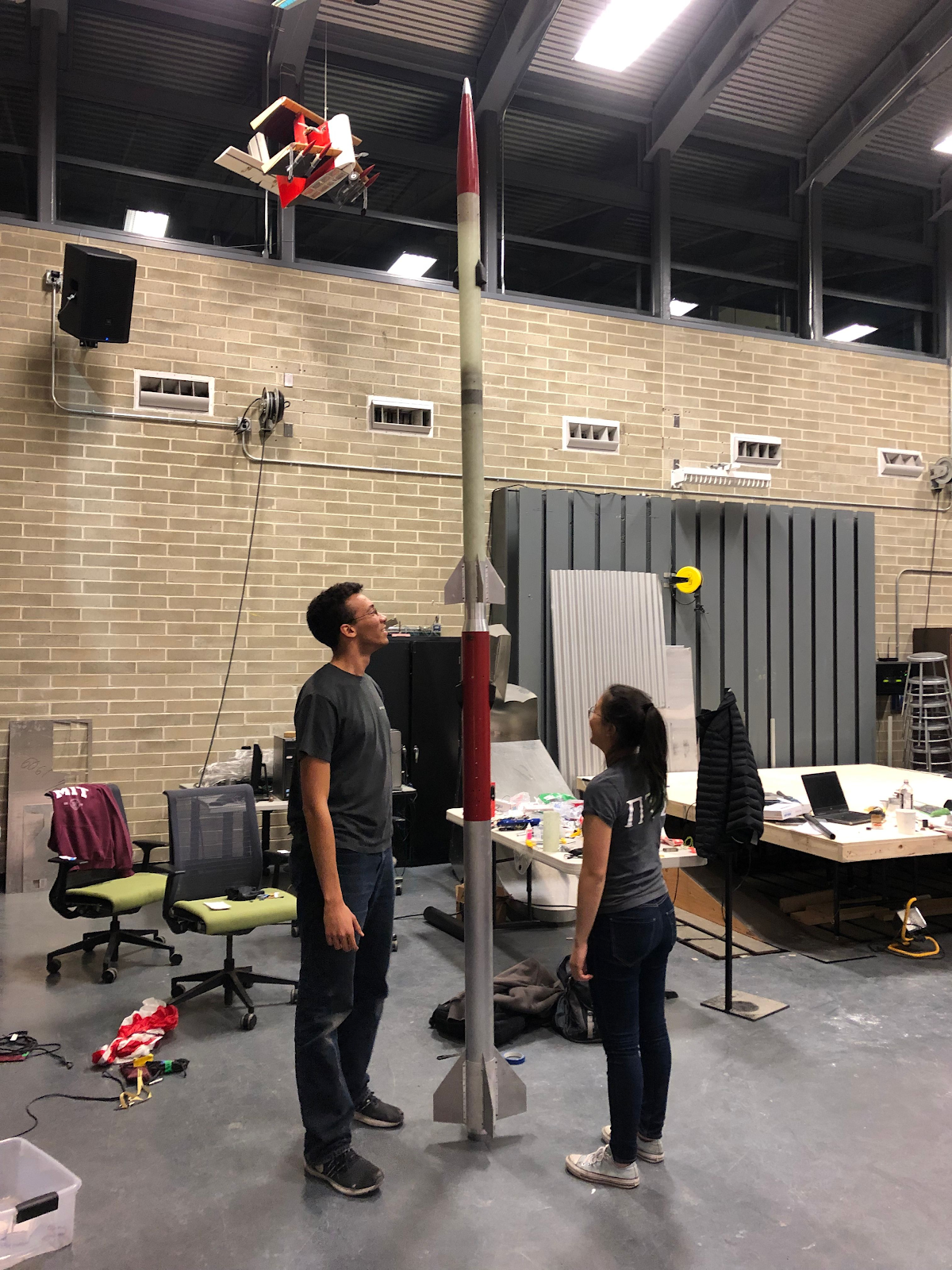 2 Rocket Team members standing next to our 2-stage rocket