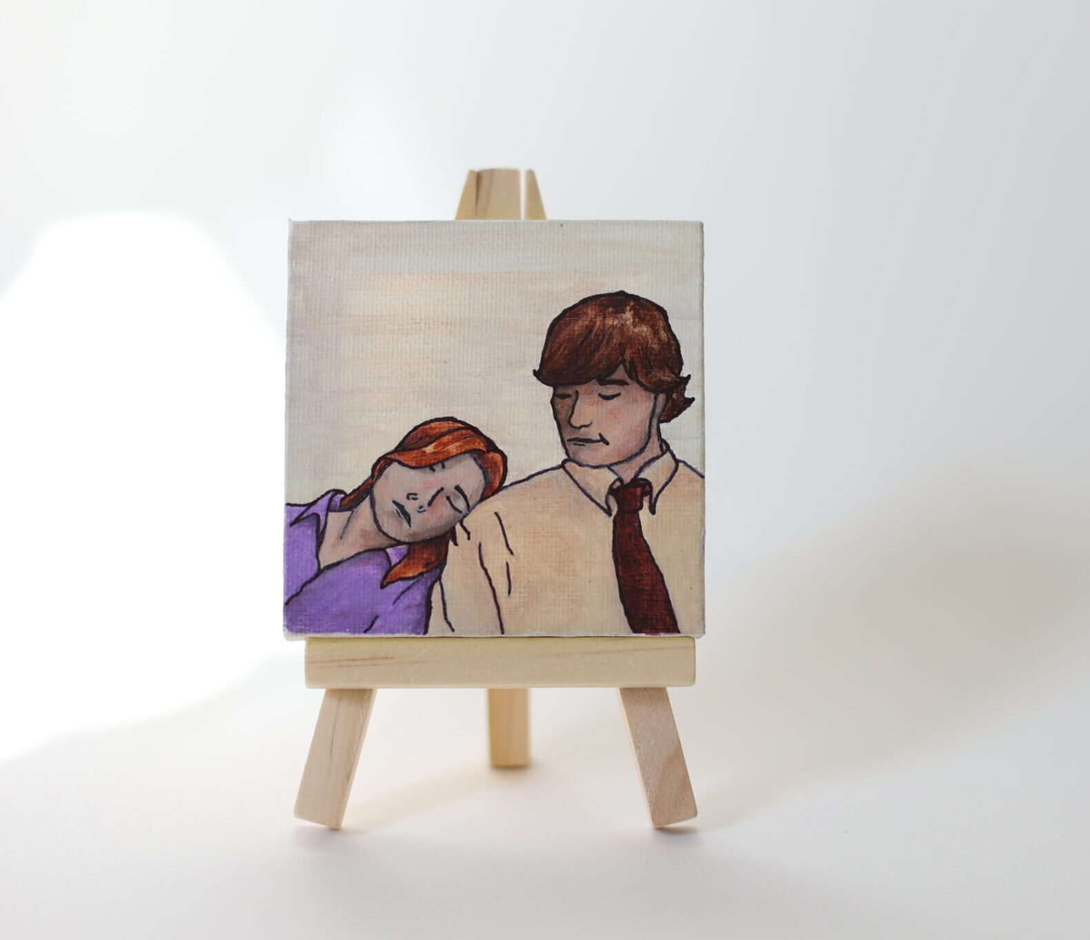 small painting of jim and pam from the office