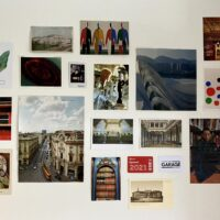 many postcards on a wall