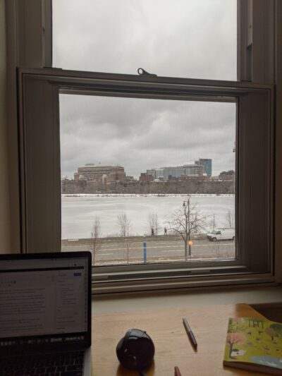 window looking out on the charles river, which is covered in snow
