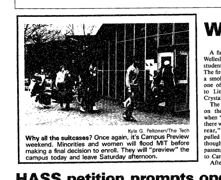 screenshot of newspaper picture, students walking into a building carrying suitcases