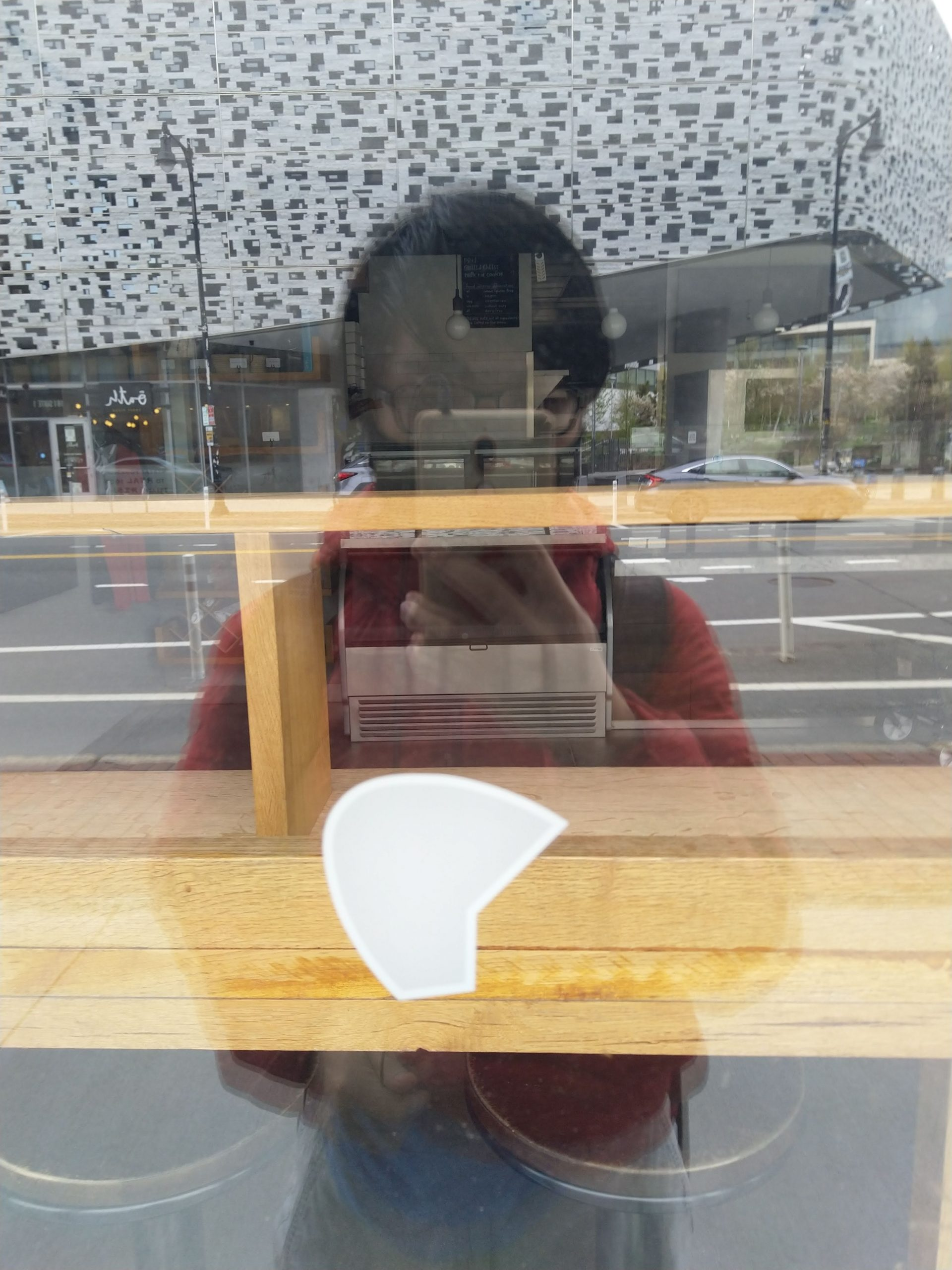 reflection of myself in a shop mirror