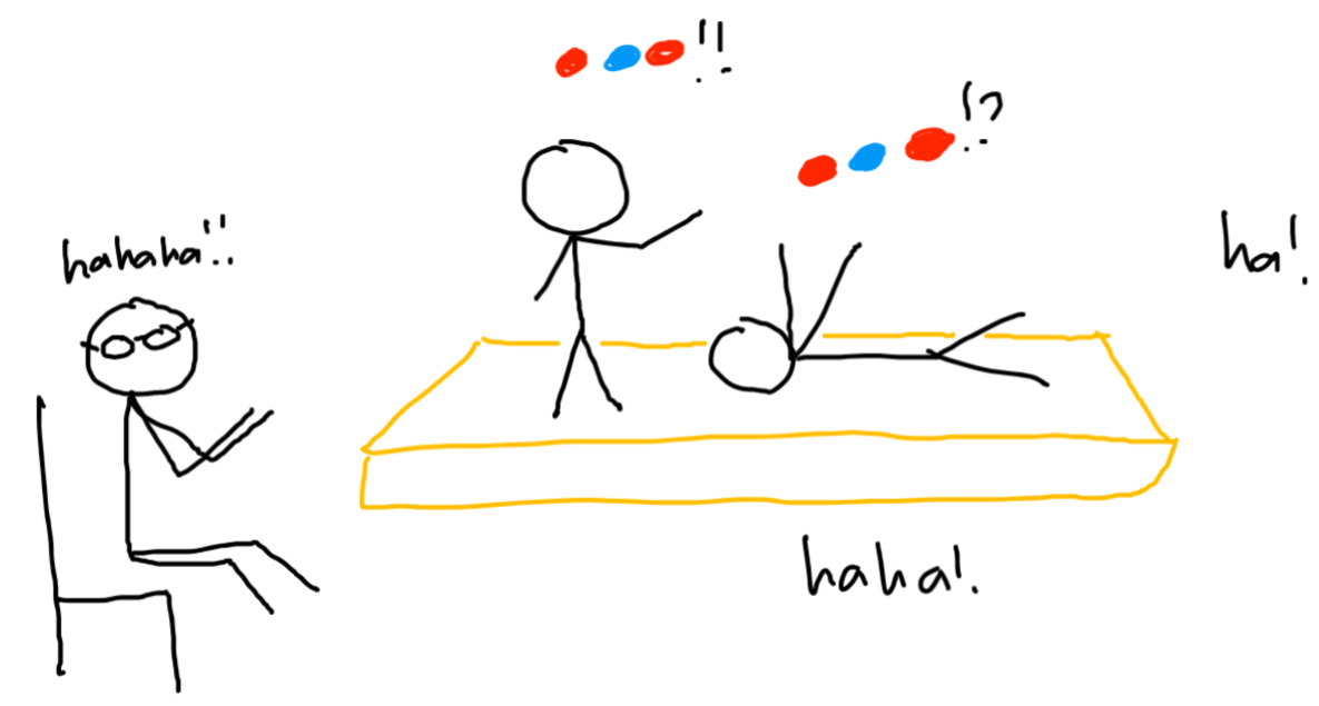 on a stage, two people talk in colored circles. a person with glasses sitting on a chair laughs and claps. there's laughing from the rest of the audience.