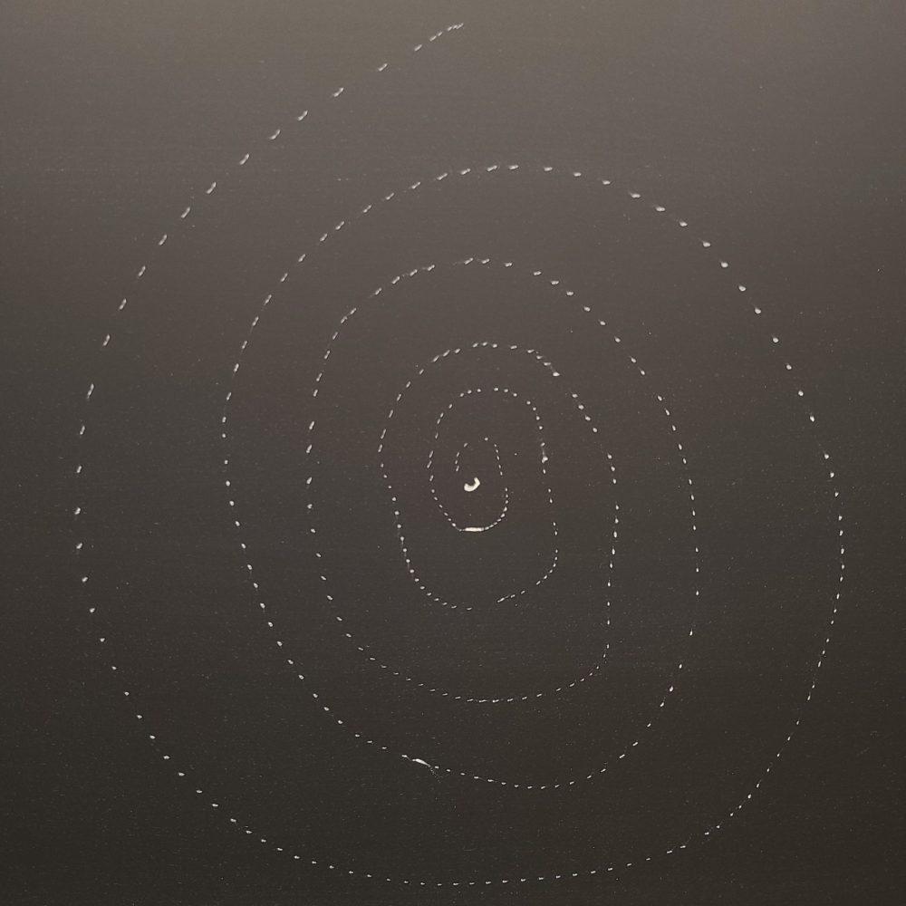dotted spiral in chalk