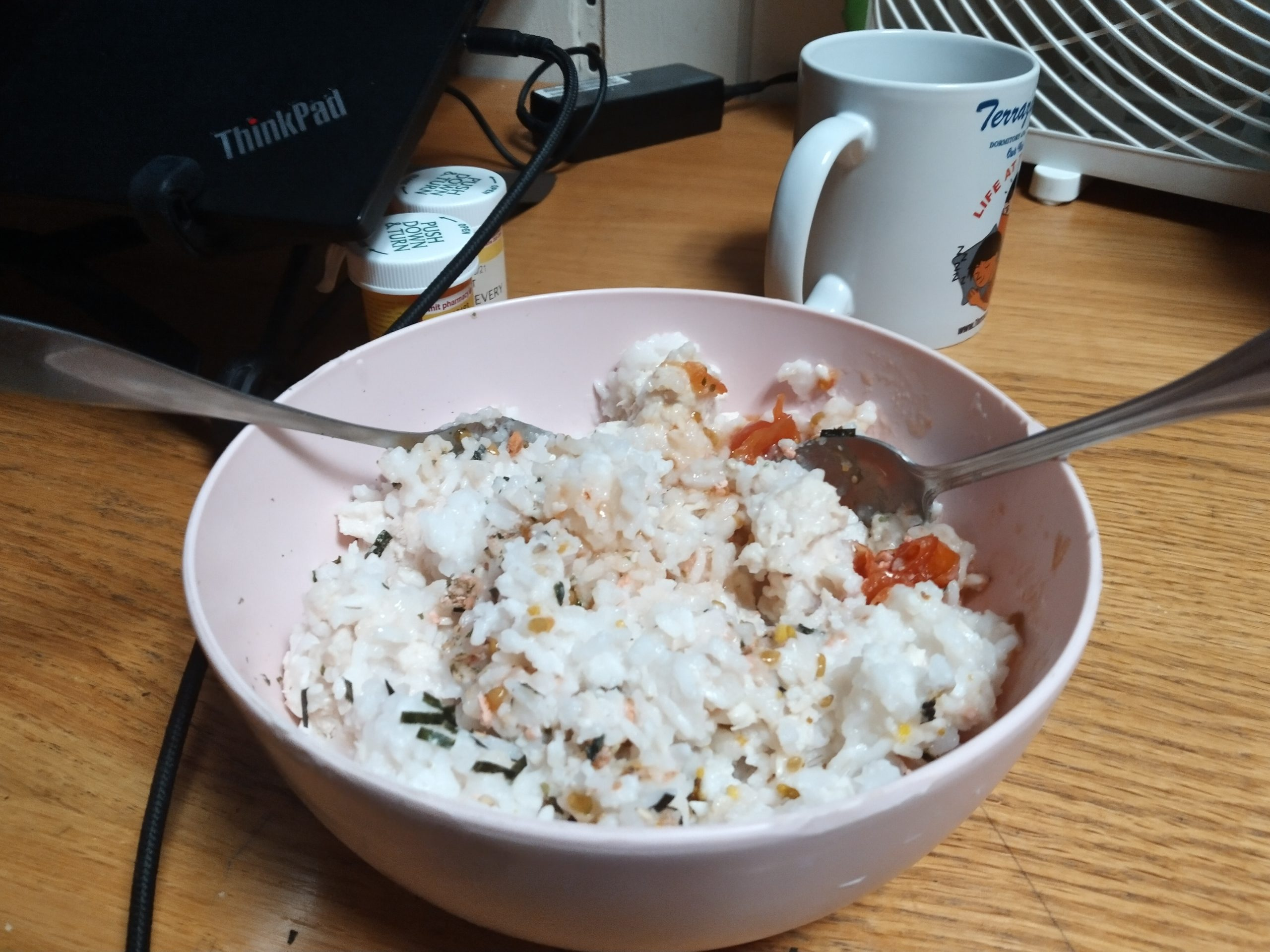 rice with chicken and tomatoes in a bowl