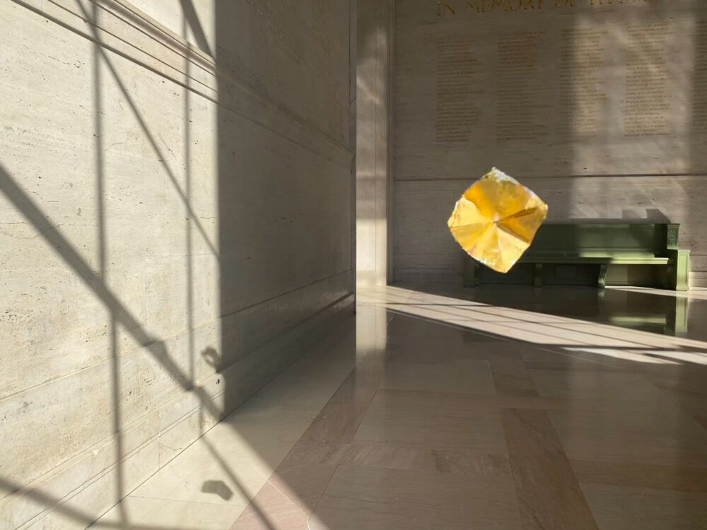 golden foil floating in an MIT lobby