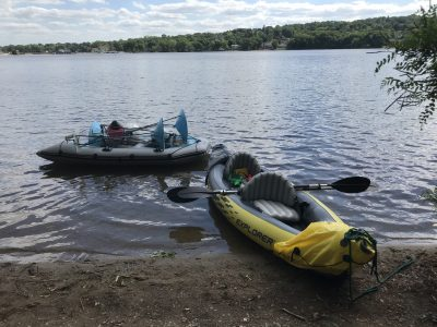 2 kayaks, one of which holds 2 methane funnels