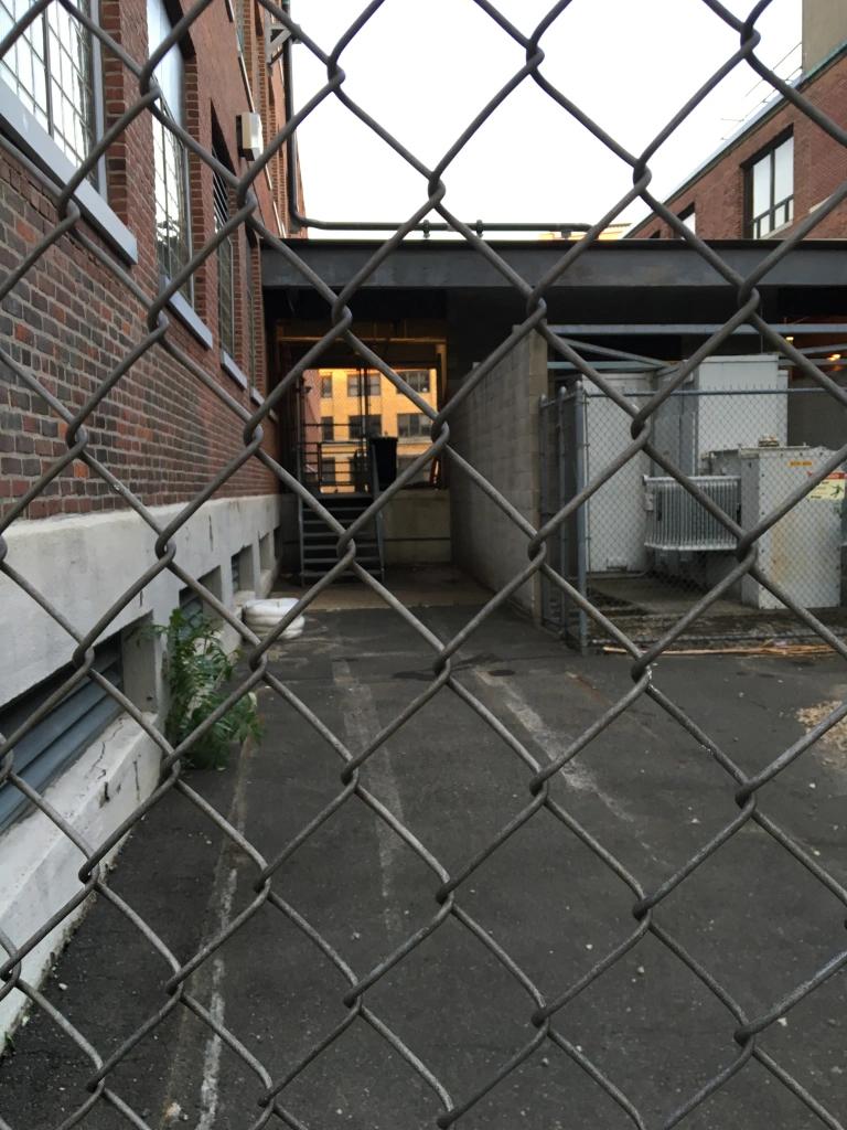 garage behind chainlink fence