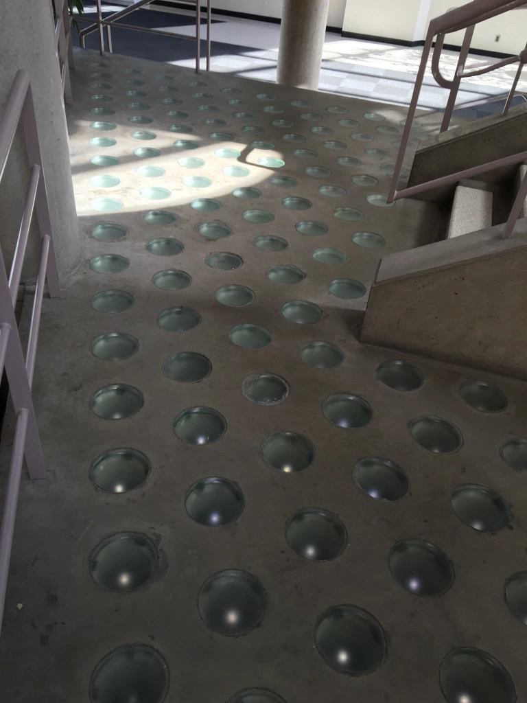 stairwell with glass circles on the ground