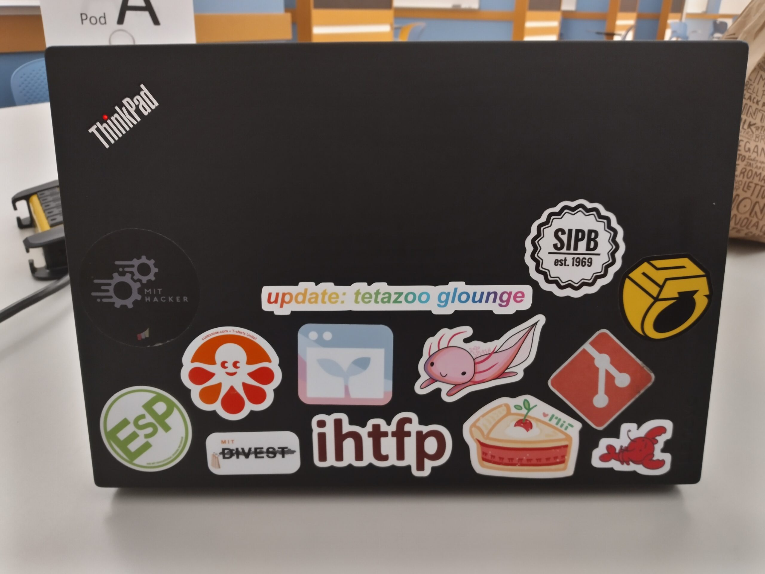 """picture of my laptop stickers with """"update tetazoo glounge"""" in the center"""